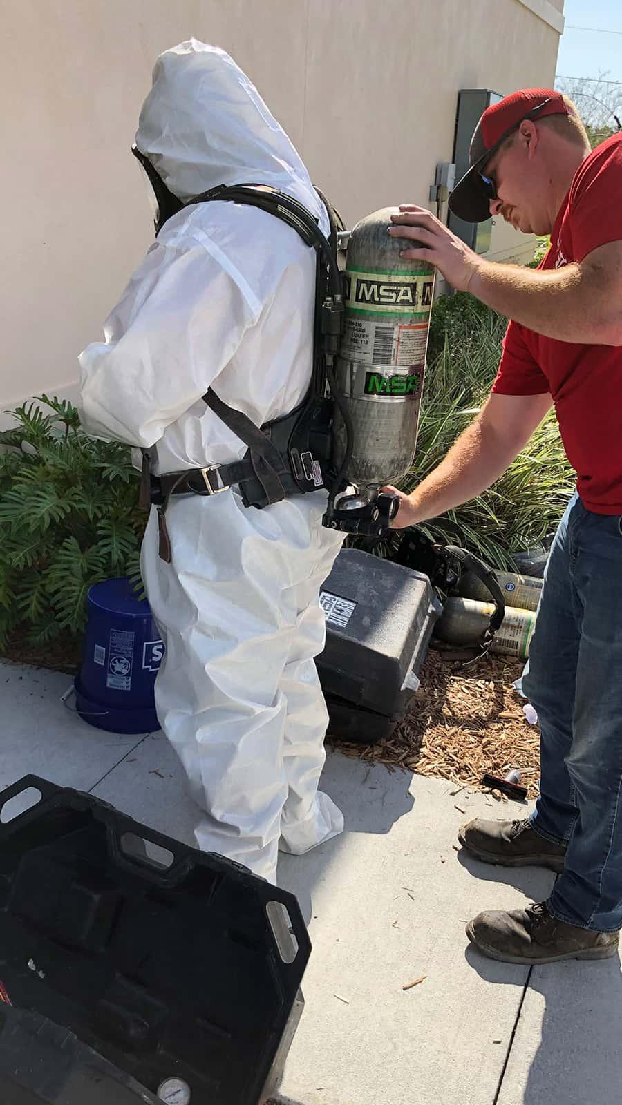 Putting on sanitization gear.